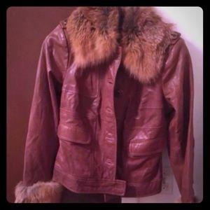 Leather jacket worn faux fur